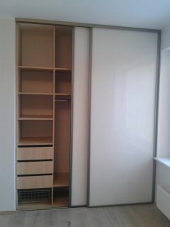 Wardrobe with white glass doors