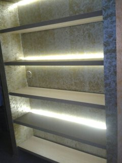 Led backlit wall shelving