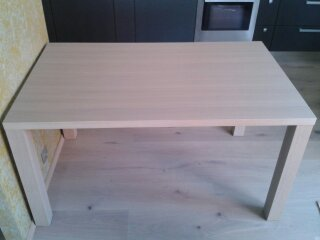 One simple dining table with oak veneer