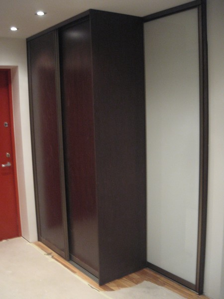 Wardrobe with wenge melamine doors and white bathroom door with glass