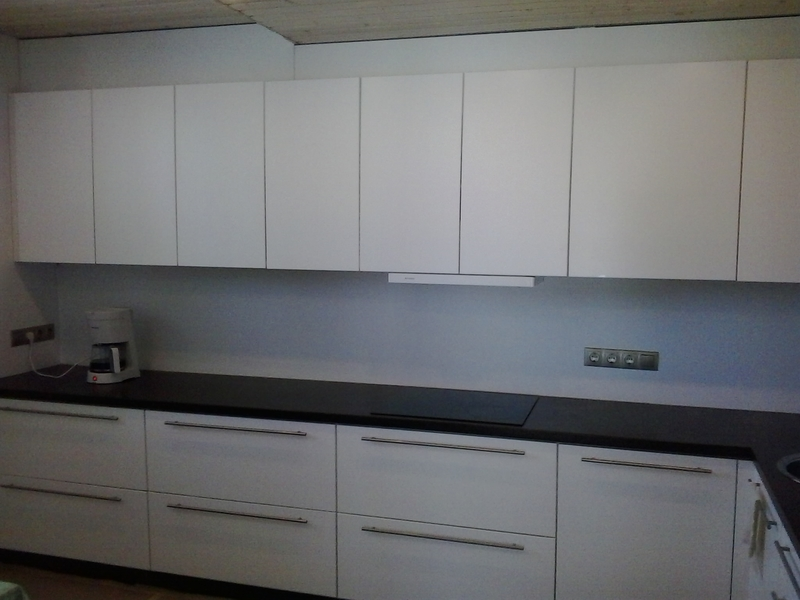 Kitchen with white painted doors