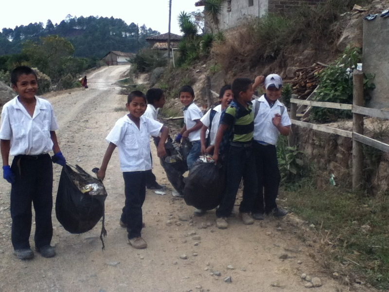 Children involved in cleaning their communities