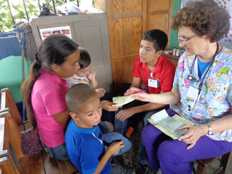 Pediatrician visiting children in the village of San Marcos de Caiquin